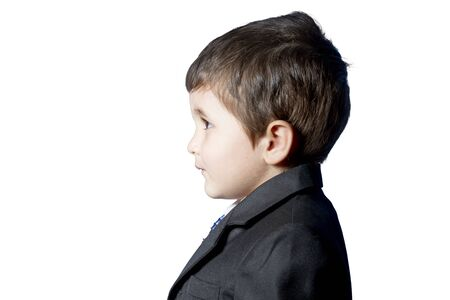 Child dressed in suit and tie photo