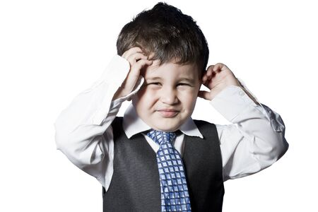 Child dressed like businessman with hands on his face funny photo