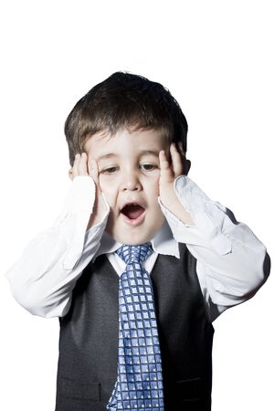 Child dressed like businessman with hands on his face surprised photo