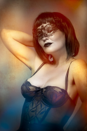 mysterious sexy woman with artistic style Venetian mask photo