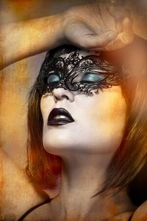 mysterious naked woman with Venetian mask intense gesture photo