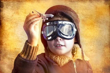 artistic portrait of child with former flight suit, with hat and sunglasses photo