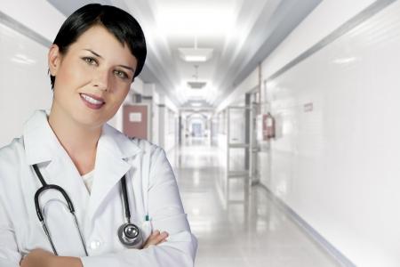 brunette female doctor on duty at white hospital corridor