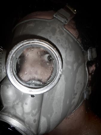 Man wear gas mask grunge background photo