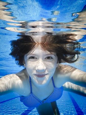underwater woman: Teenage swimming underwater in the pool