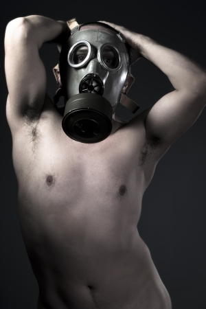 nude man with protective gas mask photo