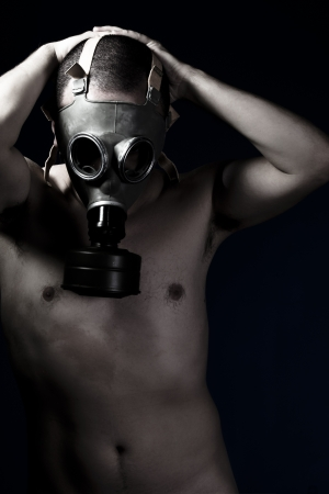 nude man with protective gas mask, pain, fear, dark photo