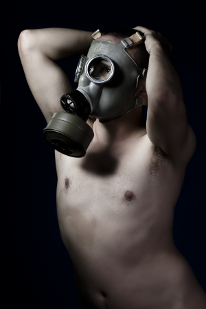 Fear, artistic nude man with gas mask photo