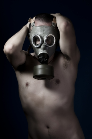Fear, shirtless man and gas mask photo