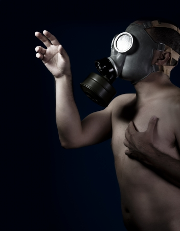 Scared, naked man with gas mask photo