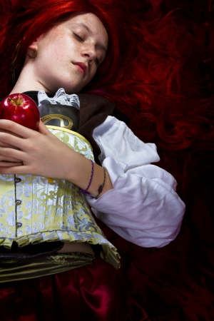 poetic: Young woman with red apple in a poetic representation