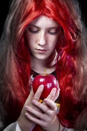 poetic: Girl with red apple in a poetic representation