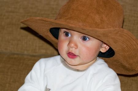 beautiful blond boy with cowboy hat photo