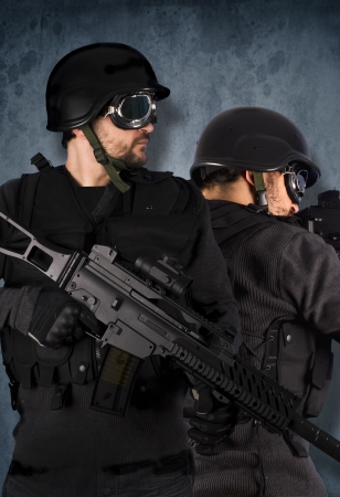 Two soldiers, swat and police concept