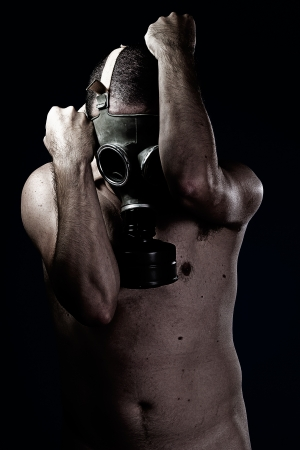 Man in gas mask, nude portrait, concept Stock Photo - 16959283