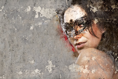 defiance: Portrait of beautiful woman over dirty wall with venetian mask