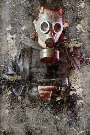Artistic portrait with textured background, man armed with gas mask photo