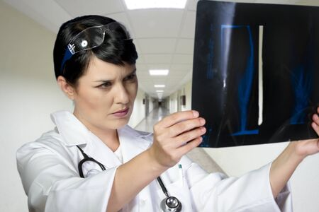 Female doctor looking at an x-ray in a hospital photo