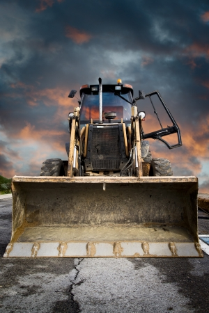 Bulldozer, Yellow tractor on dramatic sky background
