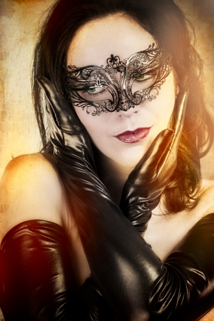 Widow sensual woman with artistic style Venetian mask photo