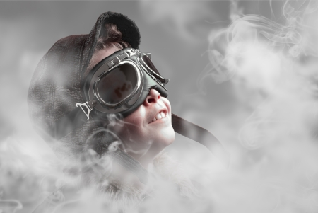 Boy pilot smiling into smoke photo