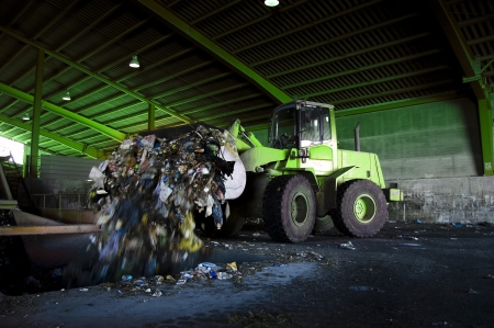 regenerated: Recycle, overview of refuse collection with bulldozer Editorial