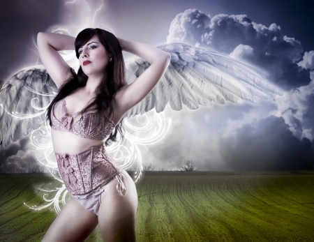 Picture a beautiful angel flying girl in pink lingerie photo