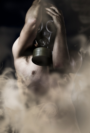 Suffering, naked man with gas mask, retro photo