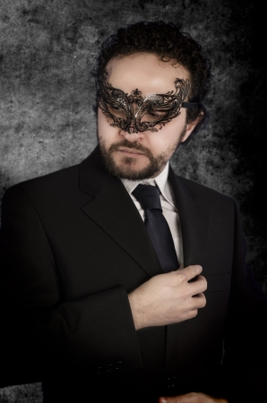 hot boy: businessman with beard and black suit on artistic background