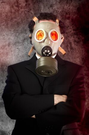 businessman with gas mask, risk concept photo