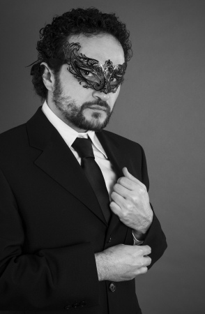 businessman with beard and black suit on artistic background, black and white photo