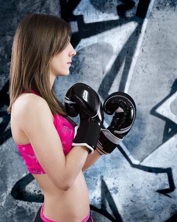 Sensual and sexy Boxing Woman over grafitti background photo