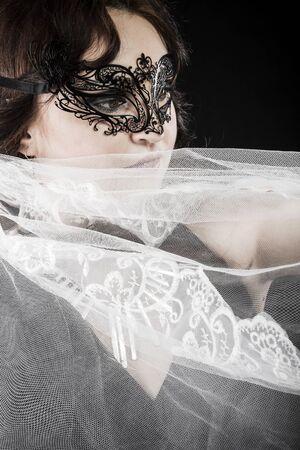 Hiding bride, Wedding decoration, Fine-art portrait of elegant girl in veil photo