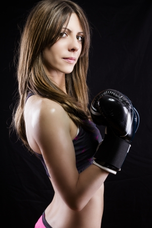 female boxer: Young woman with boxing gloves