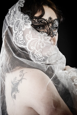 Young brunette beauty or bride, behind a white veil, spain photo