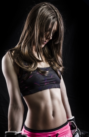 Sensual and fit young woman with boxing gloves photo