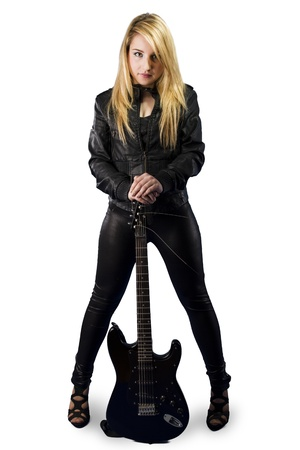 Beautiful young blonde dressed in black leather with electric guitar on white background photo
