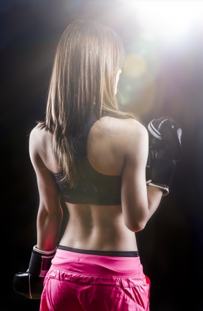 back muscled young female boxer photo
