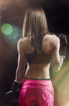 back muscled young female boxer, fitness photo