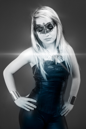 beautiful young blonde at a party, dressed in leather, silver lights and glitter photo