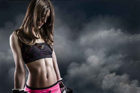 beautiful woman athlete on Cloud Background, fitness