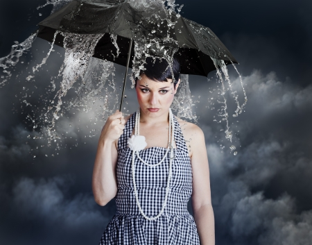 woman with black umbrella in heavy rain photo