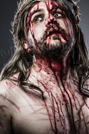 Jesus Christ with crown of thorns white on the cross, Easter in Spain photo