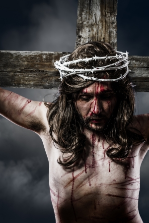 Jesus Christ with crown of thorns white on the cross of Calvary representation photo