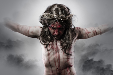 the crucifixion: representation of jesus christ on the cross on Cloud Background Stock Photo