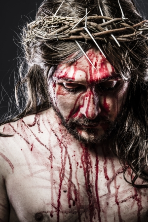 christmas religious: calvary jesus, man bleeding, representation of passion Stock Photo