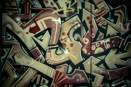 Colorful graffiti, abstract grunge grafiti background over textured wall