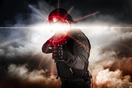 gun: Soldier aiming assault rifle laser sight Stock Photo