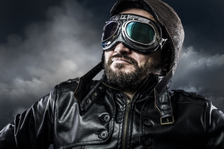 aeronautical: Aviator with glasses and vintage hat with proud expression