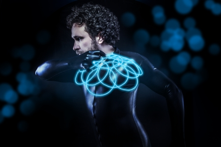 fantasy and science fiction, black latex man with blue neon disk photo